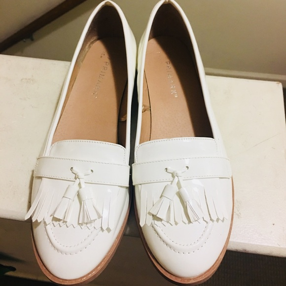 White Patent Leather Flats With Tassels